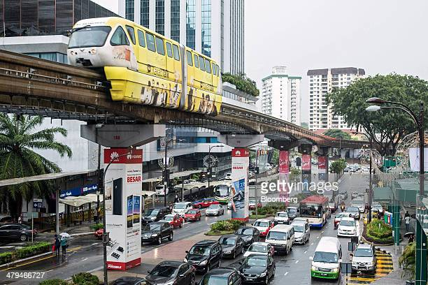 Monorail train, operated by Rapid Rail Sdn Bhd, moves along an elevated track above road traffic in Kuala Lumpur, Malaysia, on Tuesday, March 18,...