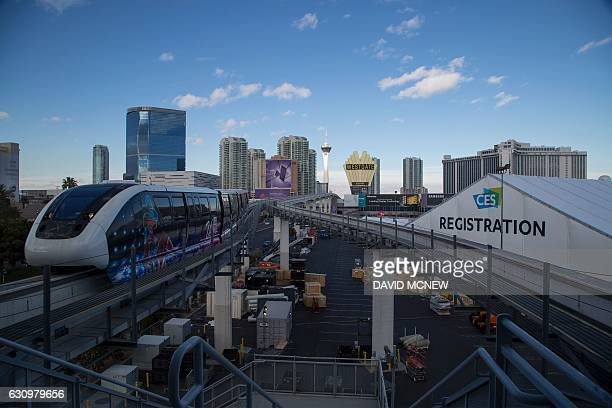 A monorail train passes as crews continue preparations on the eve of opening day for the 2017 Consumer Electronics Show at the Las Vegas Convention...