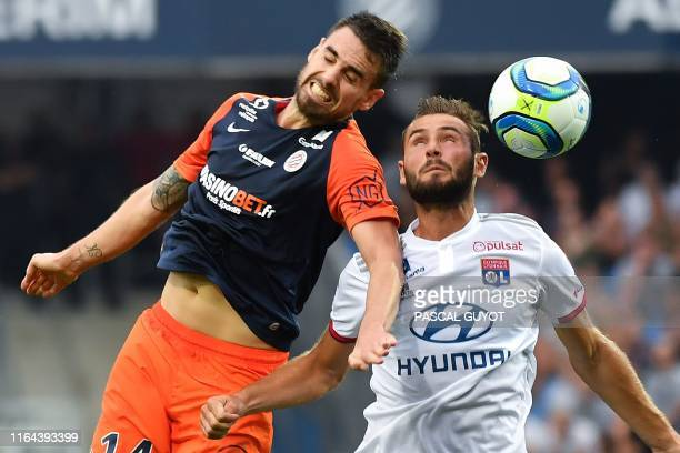 Monptellier's French midfielder Damien Le Tallec heads the ball with Lyon's French midfielder Lucas Tousart during the French L1 football match...