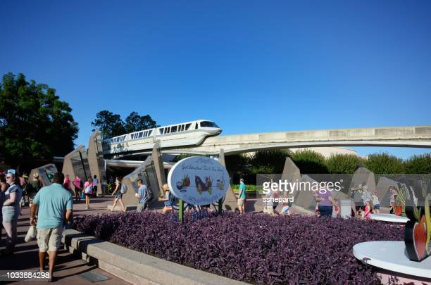 monrail passing through epcot near gates - monorail stock pictures, royalty-free photos & images