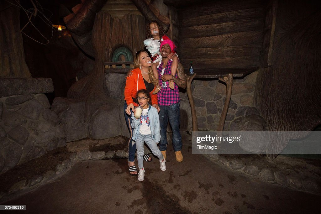 Monroe Cannon, Mariah Carey, Moroccan Cannon, and Nick Cannon prepare to ride Splash Mountain at Disneyland on April 30, 2017 in Anaheim, California.