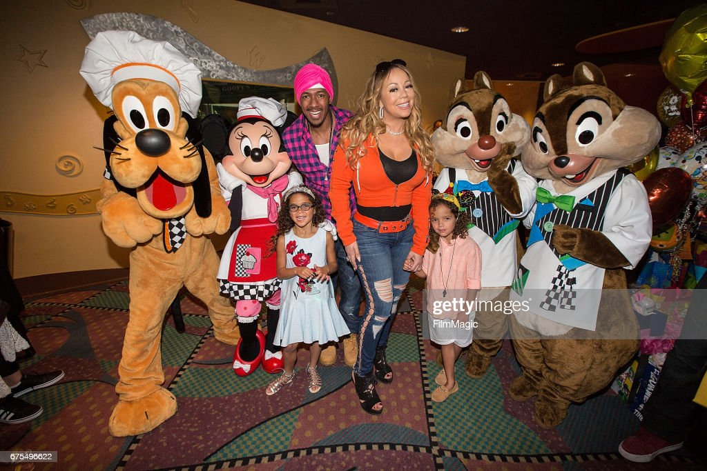 Monroe Cannon, Nick Cannon, Mariah Carey, and Moroccan Cannon pose with Disney characters at Disneyland on April 30, 2017 in Anaheim, California.