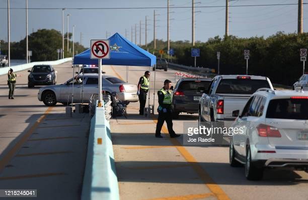 Monroe County Sheriff deputies man a checkpoint on US 1 leading into the Florida Keys on March 27 2020 in Florida City Florida Monroe County...