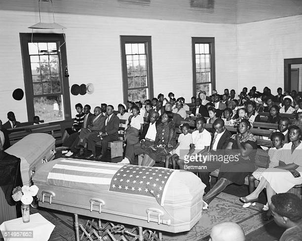 The flagdraped casket of exsoldier George Dorsey and the casket of his sister Dorothy Dorsey Malcolm are shown in the Mt Perry Baptist Church here...
