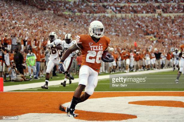 J Monroe of the Texas Longhorns returns a kickoff for a touchdown against the Louisiana Monroe Warhawks on September 5 2009 at Darrell K RoyalTexas...