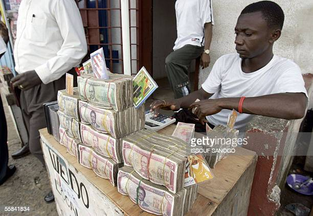 Bundles of Liberian dollars rest on the table of a money exchanger in Monrovia the capital of Liberia 03 October 2005 The country has been crippled...