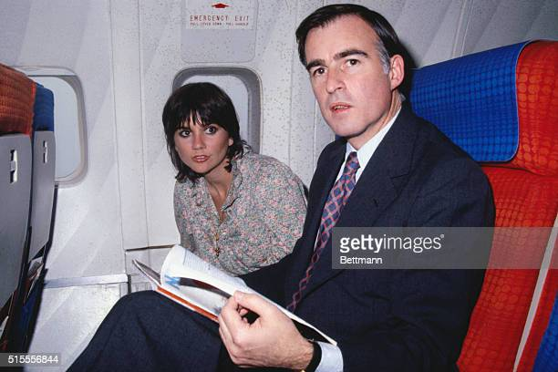 California Governor Edmund G Brown and rock singer Linda Ronstadt aboard plane as arrive here They are on way to Kenya for a safari trip Miss...