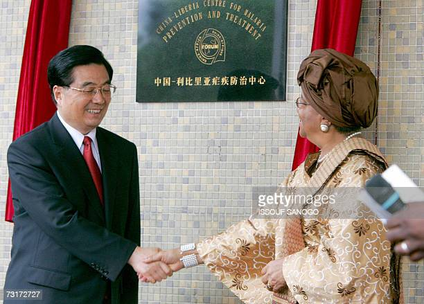 Chinese President Hu Jintao shakes hands with his Liberian counterpart Ellen Johnson Sirleaf after they inaugurated an anti-malaria prevention centre...