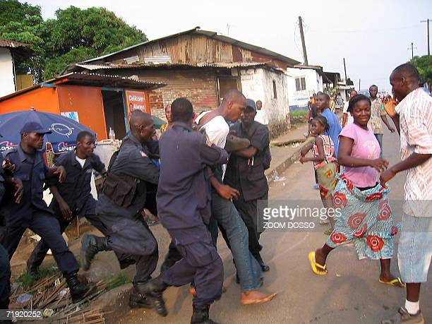 Liberia's national police force arrests a former combatant in a street of Monrovia 07 September 2006 Armed robberies hijackings killings and rapes by...