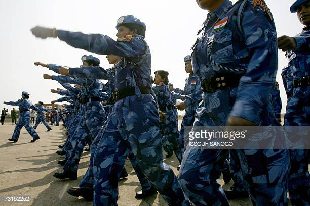 The United Nations' first all-female peacekeeping force of more than 100 Indian policewomen walks upon arrival at Roberts international airport in...