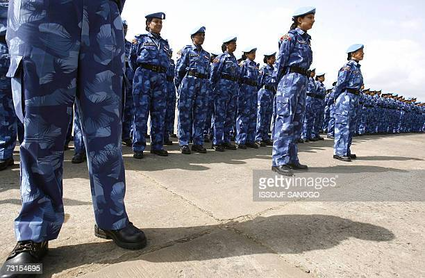 The United Nations' first allfemale peacekeeping force of more than 100 Indian policewomen stand on the tarmac upon arrival at Roberts international...