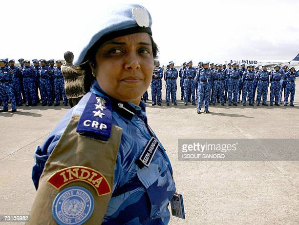 United Nations' first all-female peacekeeping force of more than 100 Indian policewomen stand guard upon arriving at Monrovia's Roberts international...
