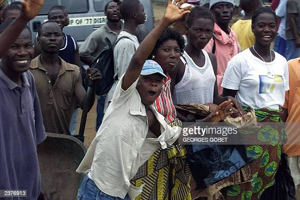 Monrovians jubilate at the arrival of the convoy of Nigerian General Festus Okonkwo and the ECOWAS advance military delegation 31 July 2003 The...