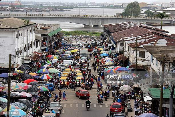 monrovia's waterside market - monrovia liberia stock photos and pictures