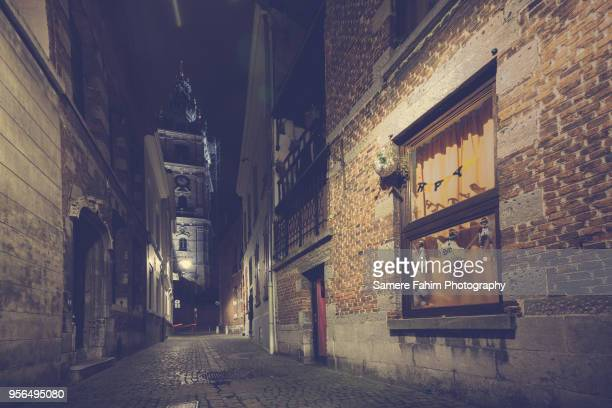 mons belfry and buildings by a halloween night - samere fahim stock photos and pictures