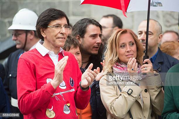 Mons Mayor Elio Di Rupo and BelgianCanadian singer Lara Fabian aplaud as they attend the Ducasse de Mons or Doudou festival in Mons on May 22 2016...