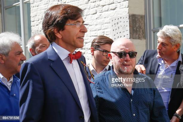 Mons Mayor Elio Di Rupo and French actor Michel Blanc walk during the Ducasse Doudou folkloric festival in Mons on June 11 2017 The Doudou festival...
