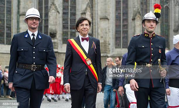 Mons Mayor Elio Di Rupo attends the celebration of the 'Ducasse de Mons' or 'Doudou' folkloric festival in Mons May 22 2016 The Doudou feast...
