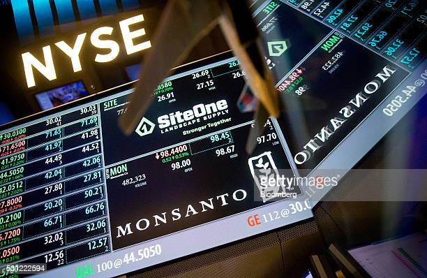 Monsanto Co signage is displayed on a monitor on the floor of the New York Stock Exchange in New York US on Friday May 13 2016 US stocks slipped amid...
