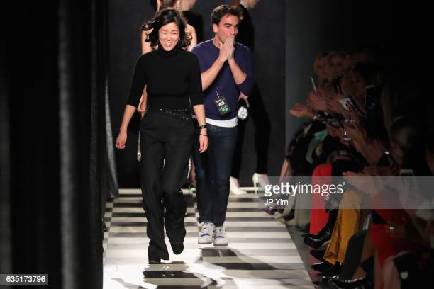 Monse designers Laura Kim and Fernando Garcia take a finale walk during the runway for the Oscar De La Renta Monse collection during New York Fashion...