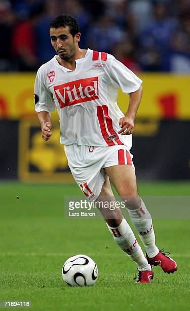 Monsef Zerka of Nancy runs with the ball during the UEFA Cup first round first leg match between Schalke 04 and AS Nancy Lorraine at the Arena Auf...