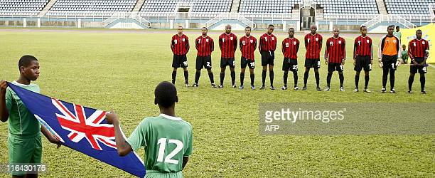 Monserrat's football team before their qualification World Cup 2014 football match against Belize at Ato Boldon stadium Couva Trinidad on June 15...