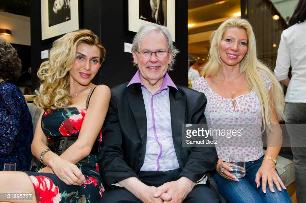 Monsieur Gadget and Nadine Rodd pose together at the Studio Harcourt exhibition at Copenhague Restaurant on May 30 2011 in Paris France