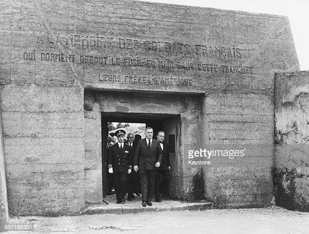 Monsieur Sanguinetti Minister over exserviceman and war victims leaving the monument where soldiers are buried in the 'Trench of Bayonets' on the...