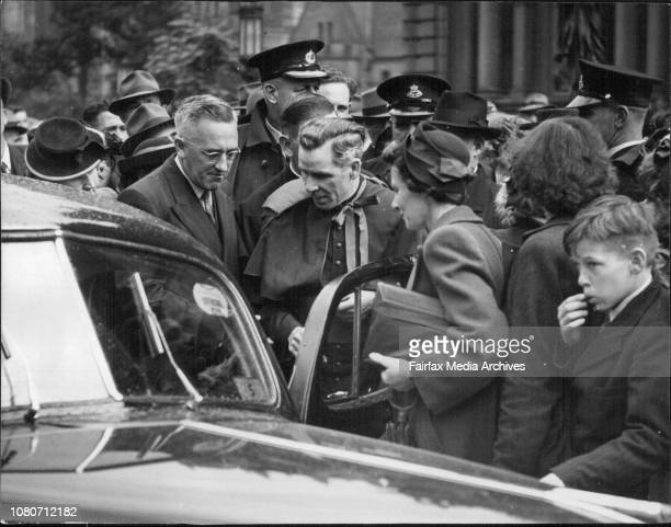 Monsignor Fulton Sheen entering his car after police had cleared a path for his through the crowd which waited outside the Town Hall today April 28...