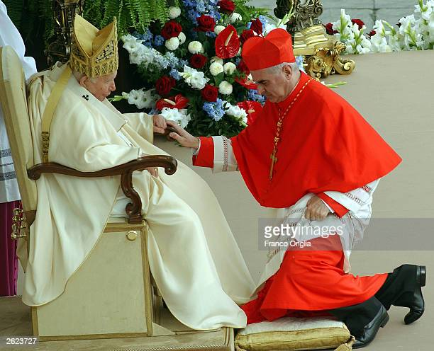 Monsignor Keith Michael Patrick O'Brien of Scotland Archbishop of St Andrews and Edinburgh receives the biretta cap from Pope John Paul II in Saint...