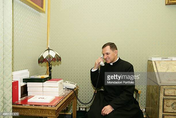 Monsignor Mieczyslaw Mokrzycki phoning in the apartments of the Apostolic Palace Vatican City 3rd July 2007