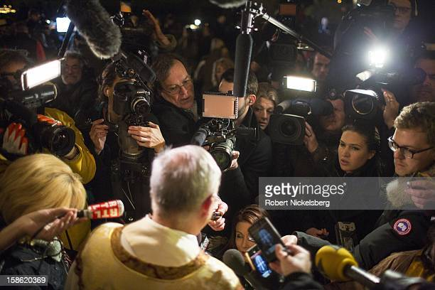 Monsignor Robert Weiss speaks to the media December 14 2012 in front of the Saint Rose of Lima Catholic Church in Newtown Connecticut following a...