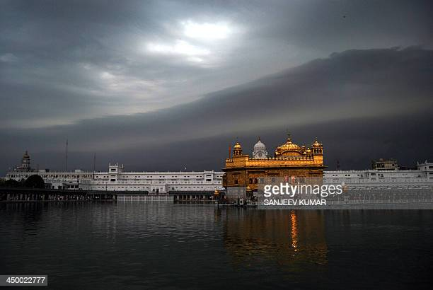 CONTENT] Monsoon clouds are seen above Golden Temple the holiest Sikh shrine in Amritsar India July 01 2010