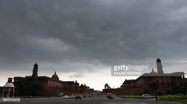 Monsoon clouds gather over North and South Block Central Sectretariate government buildings in New Delhi on August 16 2015 AFP PHOTO / SAJJAD HUSSAIN