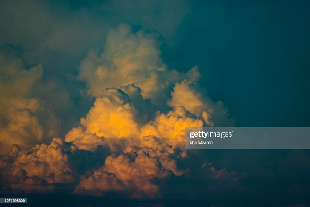 Monsoon clouds over glory sunset : Stock Photo