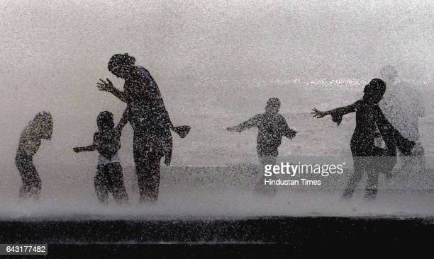 Monsoon Maharashtra received heavy rainfall since Saturday causing floods in several parts whereas revellers enjoy the waves at Worli Seaface on...