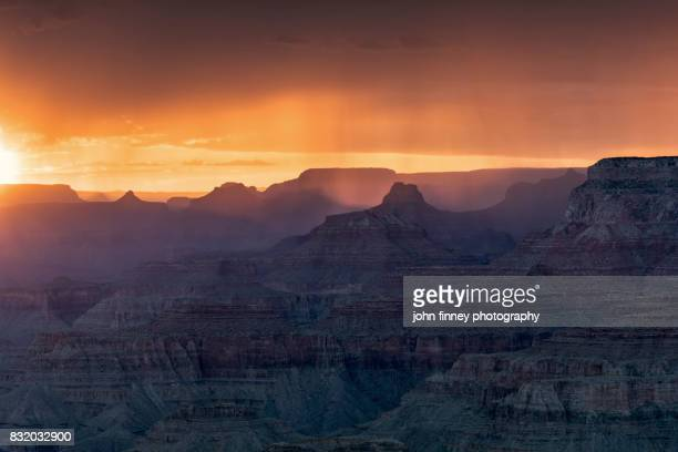 monsoon over the grand canyon at sunset, arizona. - grand canyon village stock photos and pictures
