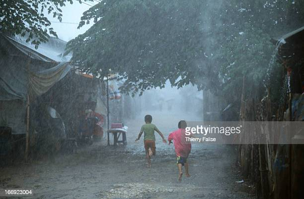 Monsoon rains flood the Hmong refugee camp where 15000 refugees are waiting to leave for asylum in America An ethnic group the Hmong tribespeople...