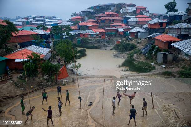 Monsoon rains hit the refugee camps as Rohingya play Sepak Takraw August 28 2018 in Balukhali refugee camp Cox's Bazar Bangladesh UN investigators...
