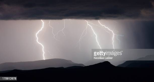 CONTENT] A monsoon thunderstorm lights up the hills above Roosevelt Lake as seen from Mt Ord Taken during Arizona's summer monsoon season