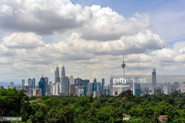 monsoon  view over downtown kuala lumpur (kl). kl is the capital of malaysia. its modern skyline is dominated by klcc, kl tower and exchange106. - shaifulzamri stock pictures, royalty-free photos & images