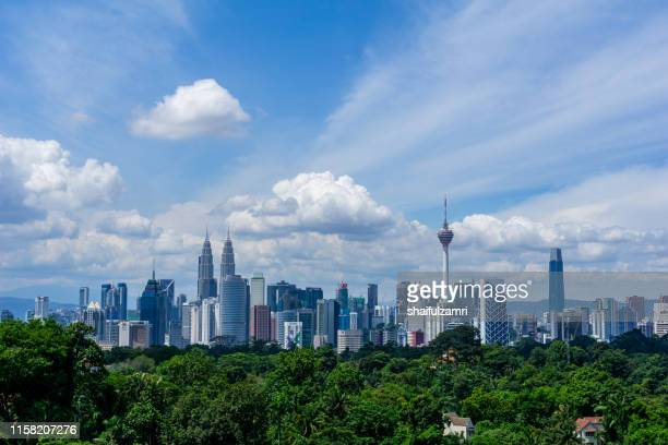monsoon  view over downtown kuala lumpur (kl). kl is the capital of malaysia. its modern skyline is dominated by klcc, kl tower and exchange106. - editorial stock pictures, royalty-free photos & images