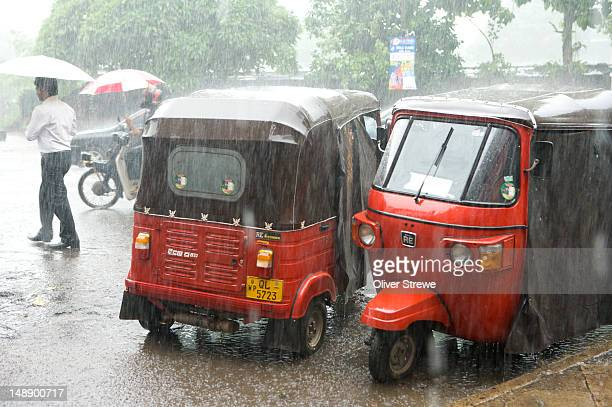 Monsoonal downpour in street.
