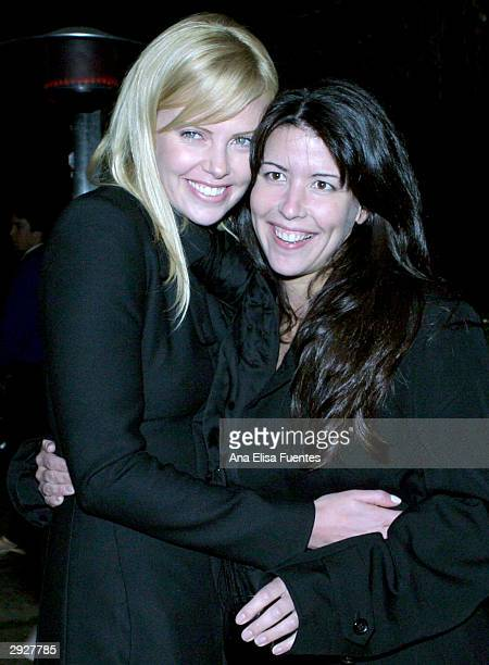 'Monster' actress Charlize Theron and Director/Writer Patty Jenkins embrace as they attend the Charlize Theron tribute at the 2004 Santa Barbara...