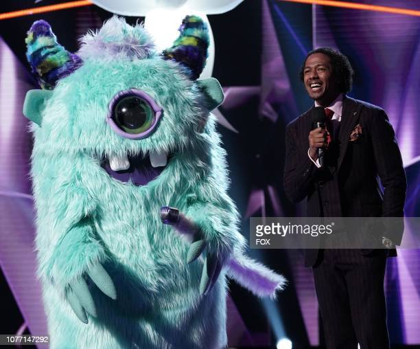 Monster and host Nick Cannon in the Mask On Face Off series premiere of THE MASKED SINGER airing Wednesday Jan 2 on FOX
