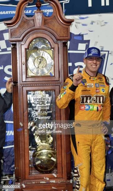 Monster Energy Chase contender Kyle Busch MMs Halloween Toyota Joe Gibbs Racing winner of the race in Victory Lane with Grandfather clock trophy at...