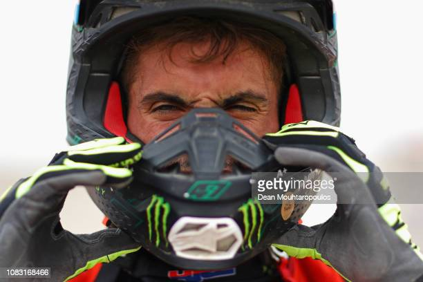 Monster Energy Honda Team 2019 No 47 Motorbike ridden by Kevin Benavides of Argentina looks on after he competes in the desert during Stage Eight of...