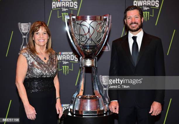 Monster Energy NASCAR Cup Series Champion Martin Truex Jr and Carolyn Visser wife of Furniture Row Racing team owner Barney Visser pose for a photo...