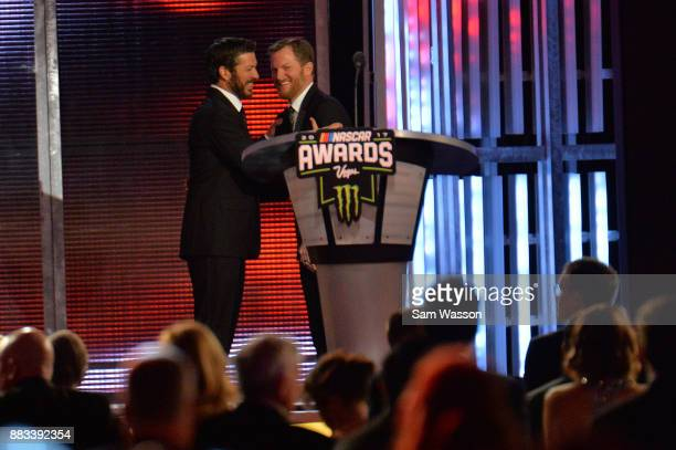 Monster Energy NASCAR Cup Series Champion Martin Truex Jr and NASCAR driver Dale Earnhardt Jr share a moment on stage during the Monster Energy...