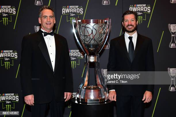 Monster Energy NASCAR Cup Series Champion Martin Truex Jr and Furniture Row Racing team president Joe Garone pose for a photo opportunity prior to...